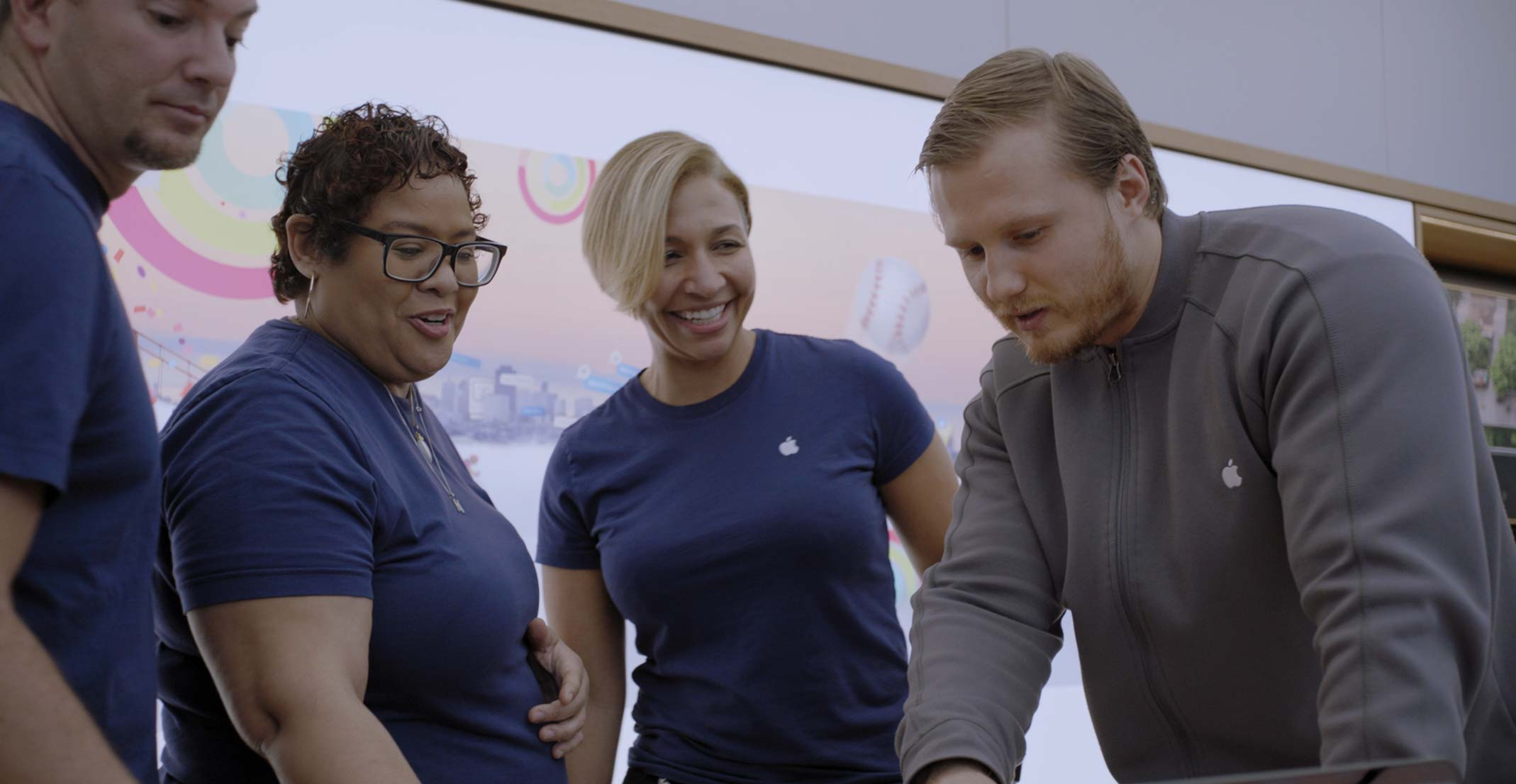 Consuela, a Store Leader at Apple Union Square, chats with team members at a store.