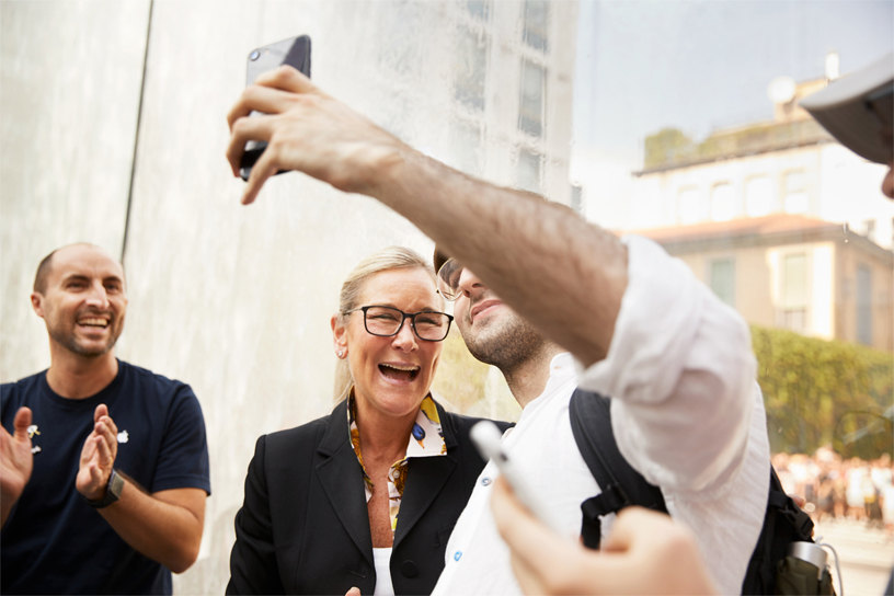 Apple's senior vice president of Retail, Angela Ahrendts, welcomes customers inside the glass fountain entrance.