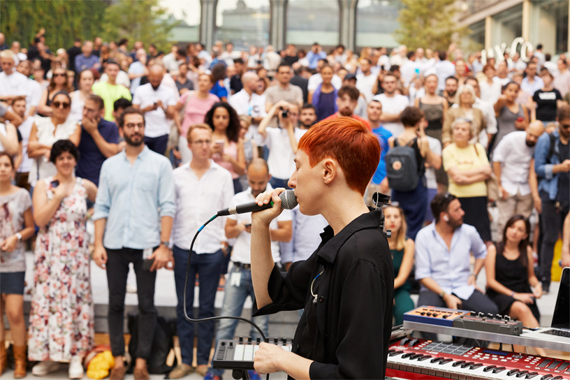 Milanese performer L I M performs in the amphitheater at Apple Piazza Liberty.