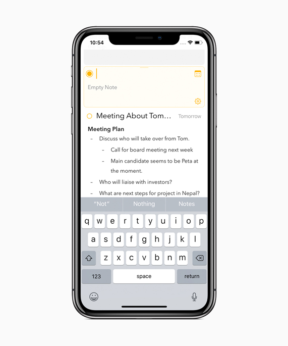 iPhone X showing an orange iTranslate screen translating a sentence in Spanish
