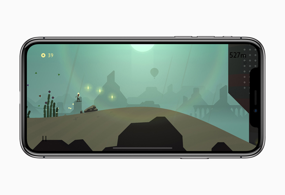 iPhone X showing a gameplay screen from the Alto's Odyssey game