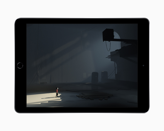 iPad showing a screenshot of a character in a dark, cavernous building from Playdead's INSIDE puzzle game