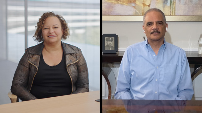 Apple's Lisa Jackson and former Attorney General Eric Holder.