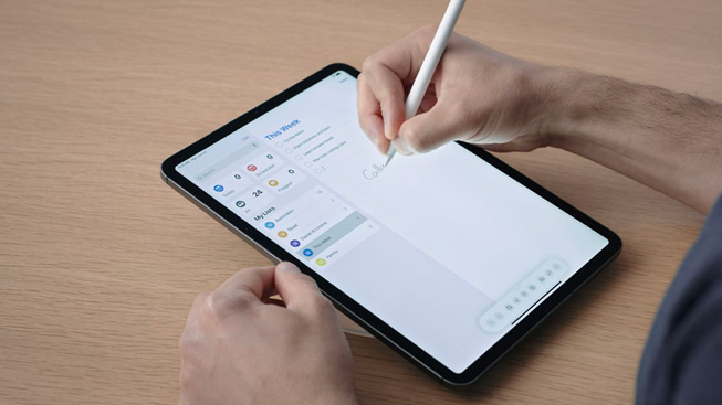 With Apple Pencil in hand, a user enters text onto an iPad Pro.