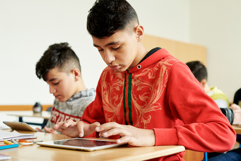 Students at Wilhelm Ferdinand Schussler Day School use iPad as a tool.