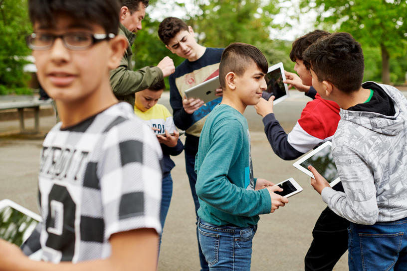 Students with iPads outside.