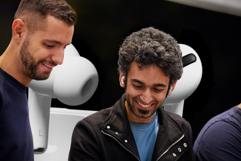 An Apple Piazza Liberty team member assists a customer with AirPods Pro.