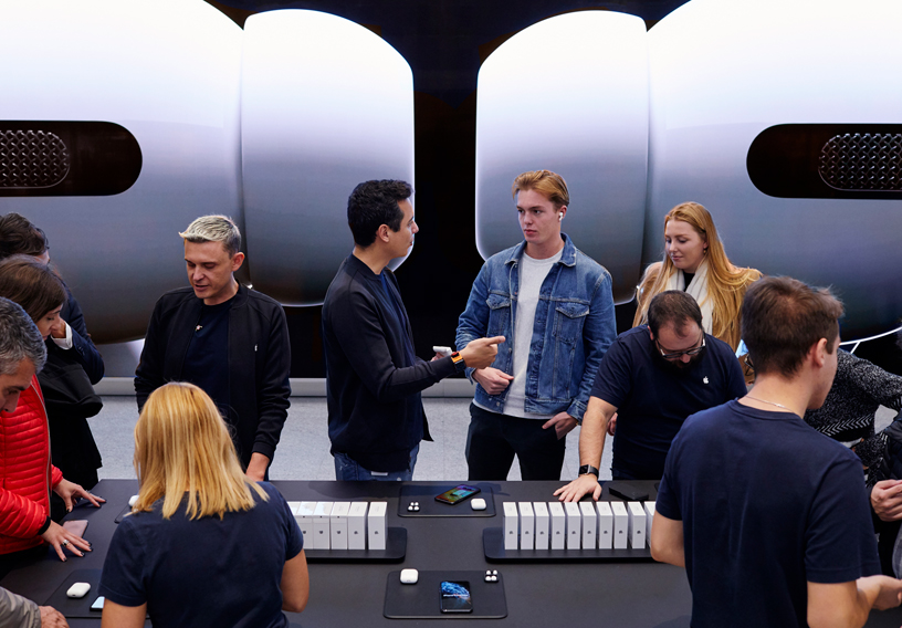 Customers test out the new AirPods Pro at Apple Piazza Liberty in Milan.