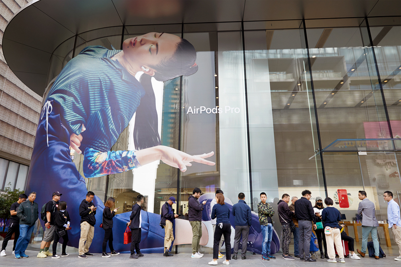 Customers line up outside Apple Nanjing East in Shanghai.