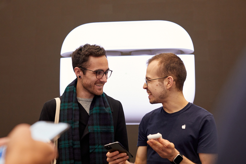 An Apple team member sets up AirPods Pro for a customer at Apple Regent Street in London.