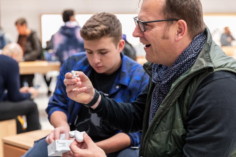 A customer unboxes AirPods Pro at Apple Fifth Avenue in New York.