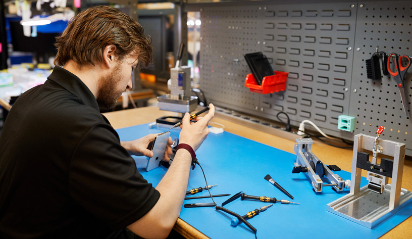An independent repair provider repairing an iPhone.