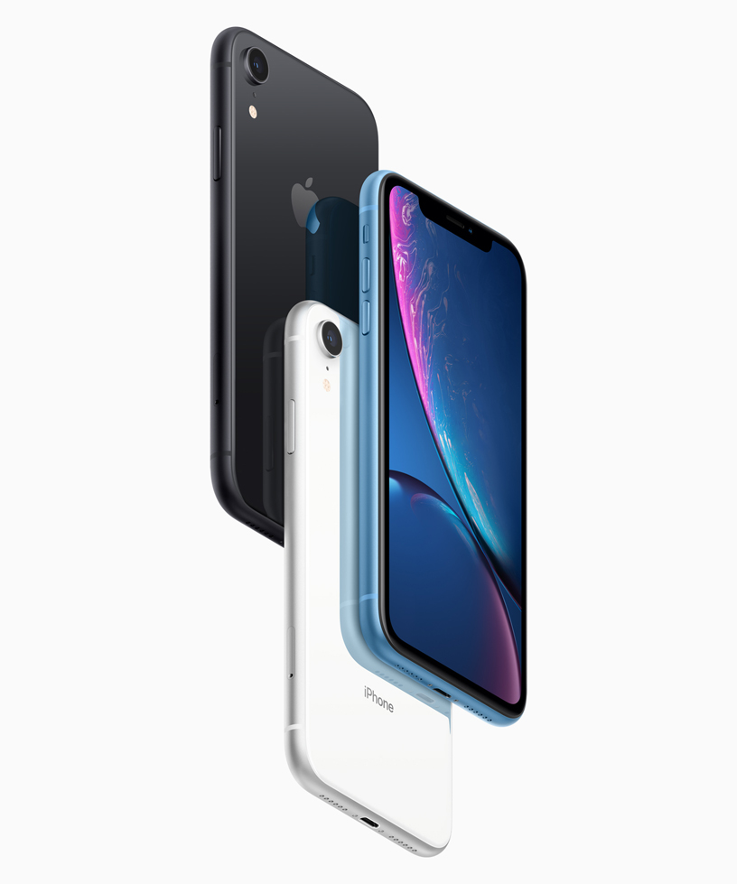 Three iPhone XR, in black, white and blue finishes.
