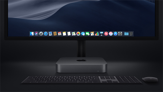 Mac mini photographed with a Magic Keyboard, Magic Mouse and display.