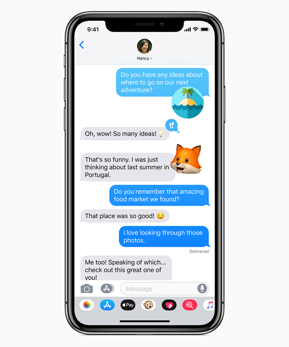 iPhone X showing Messages with Memojis.