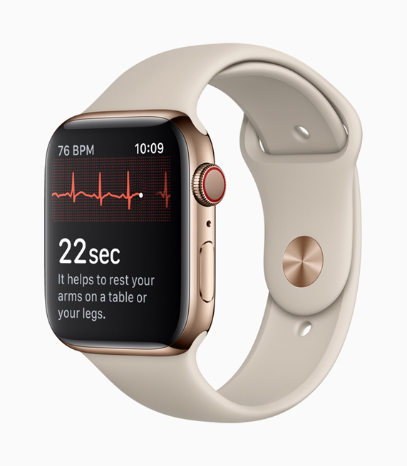 A gold Apple Watch Series 4 showing an ECG reading.