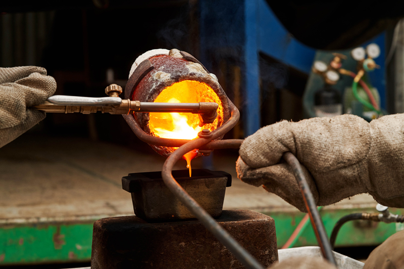 Heated gold being poured into bars.