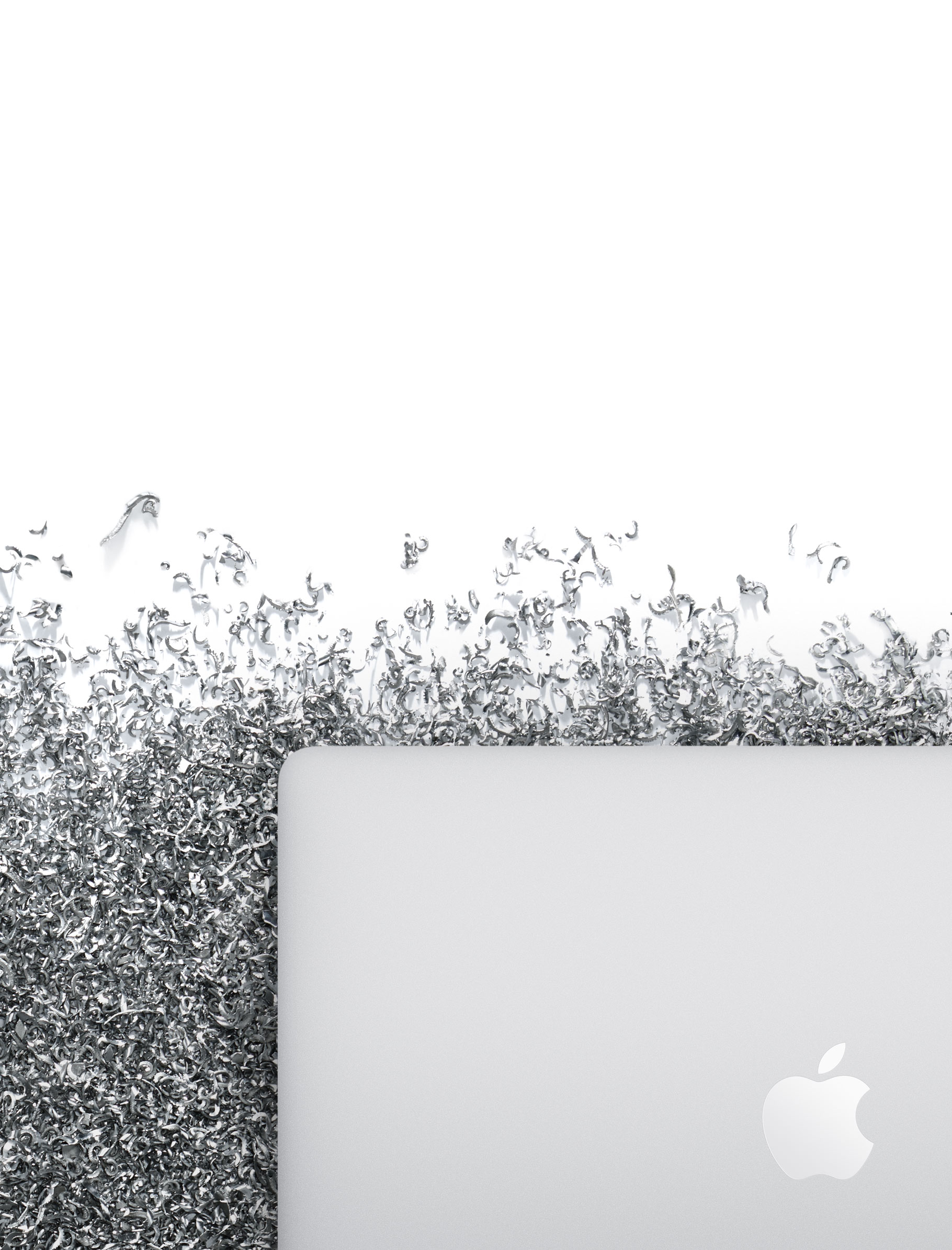 MacBook Pro surrounded by aluminum shavings